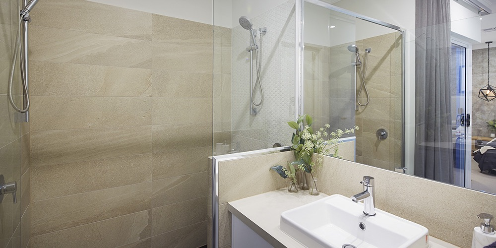 B1 Homes_The Avenue - master bathroom with two shower heads and china sink