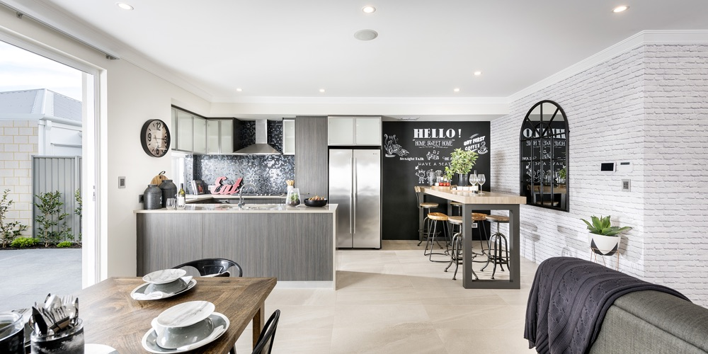B1 Homes_The Dvina Display Home - open plan dining, family living and kiten that flows out to the private courtyard
